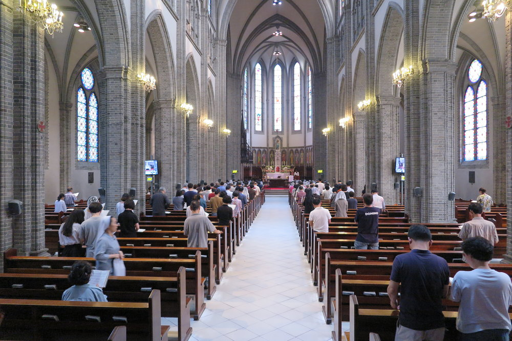 Church goers at the gorgeous Myeongdong Cathedral in Seoul. Perhaps some of these folks are praying for their children and grandchildren to be admitted into top universities?