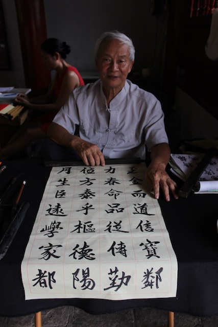 A Vietnamese man showing his skills in Chinese calligraphy at the Temple of Literature in Hanoi