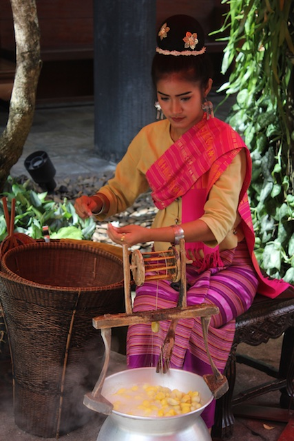A Thai woman demonstrates the ancient art of silk weaving at the Jim Thompson House