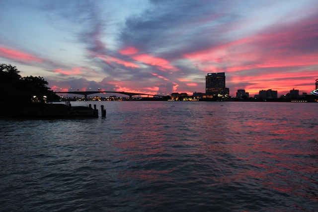 Sunset over the Chao Phraya River in Bangkok from the docks of the Asiatique shopping area