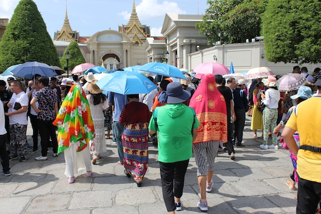 A colorful crowd enters the temple complex at Wat Phrat Kaew
