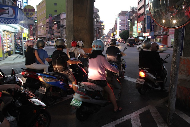 Helmets galore: motorcyclists on a street in Hsinchu