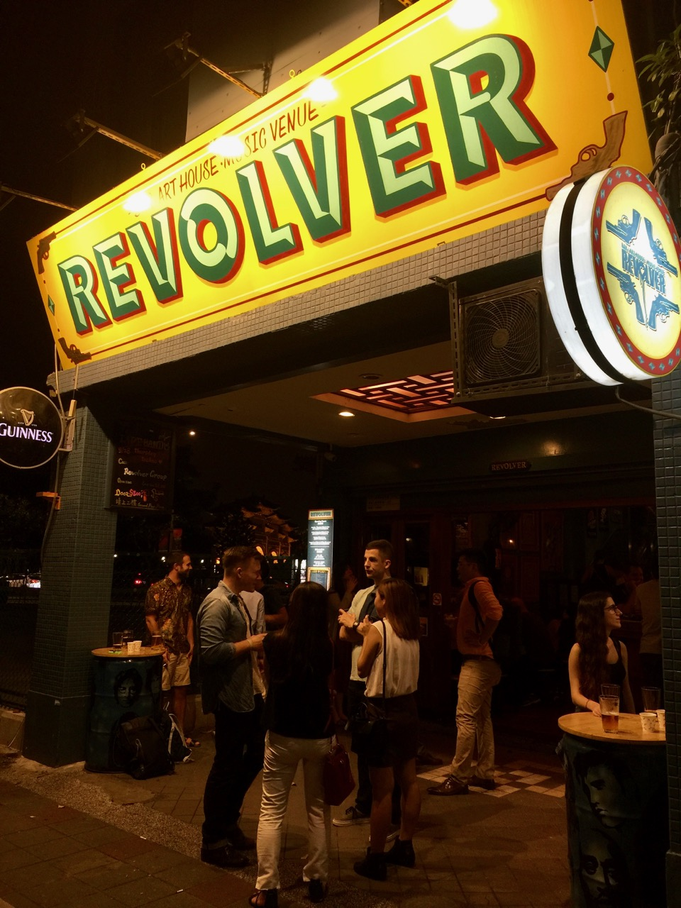 Young hip foreigners and Taiwanese hanging out outside the entrance to Revolver, a popular live music bar in Taipei