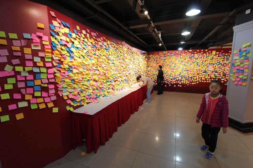 Visitors to the Workers Culture Palace leave notes to honor the CCP