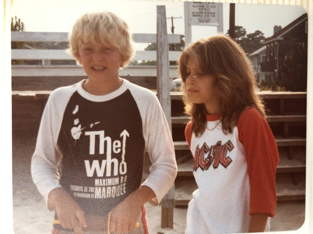 At Rehoboth Beach, Delaware, c. 1982: my sister Robin and I are sporting our favorite band Ts while flying a kite.