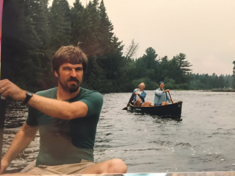 My step-dad, Andy Bodge, in his bearded days, canoeing along a Massachusetts river with my Uncle Dick and Aunt Jutta in the background, early 1980s