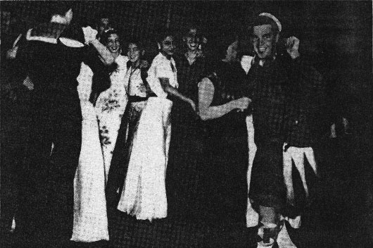 Sailors dancing with international hostesses in a Blood Alley bar