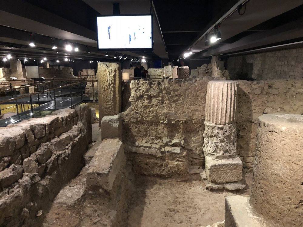 Passing through the remains of a Roman settlement and church from an earlier age of Barcelona's long history