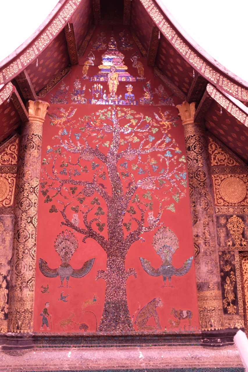 "The ""tree of life"" mosaic on the back of the main temple in Wat Xieng Thong"