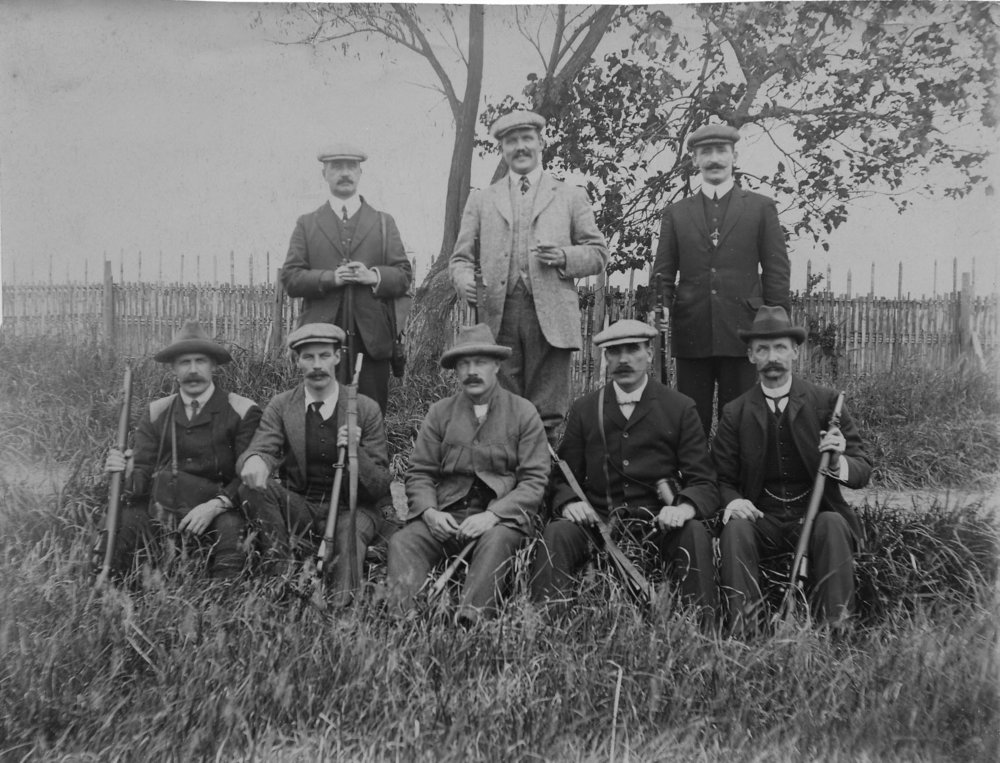 S. C. Young (second from left in foreground) posing with other members of the SMP rifle team