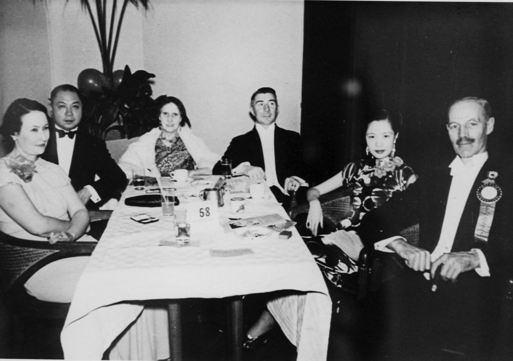 S. C. Young (far right) and Mrs. Young (third from left) at a dinner party c. 1938, on the eve of his retirement from the police force
