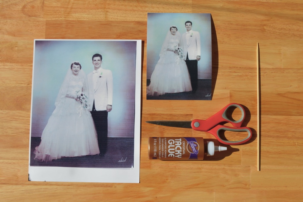 To make the cake topper you'll need a copy of a old photograph, cardstock, glue, a wood skewers, and scissors.