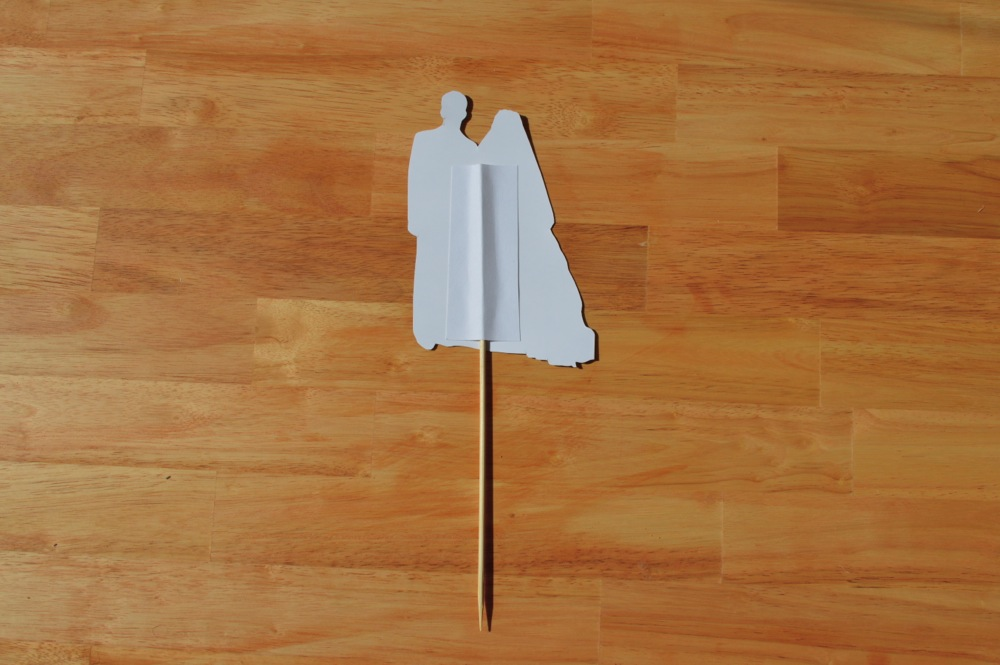 Glue down a strip of cardstock on top to sandwich the skewer in between.