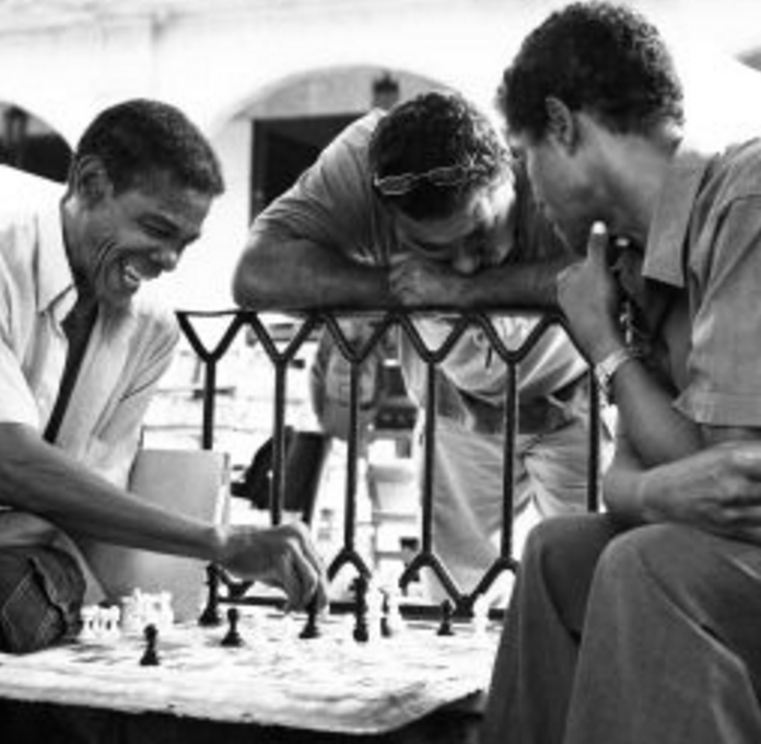 "Now What Was I Winning?   ""This guy was beyond a character. Unlike most Cubans, he spoke perfect English with a giddy little stride in his voice, constantly asking us hilarious questions about our knowledge of football, resuming to his game of Chess and then upon remembering our presence repeating, ""Now what was I saying?"" He was a cheeky damn Chess player if ever I've seen one. """