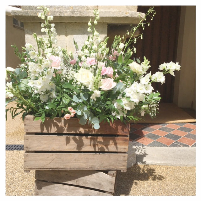 Crate of flowers for Church ceremony