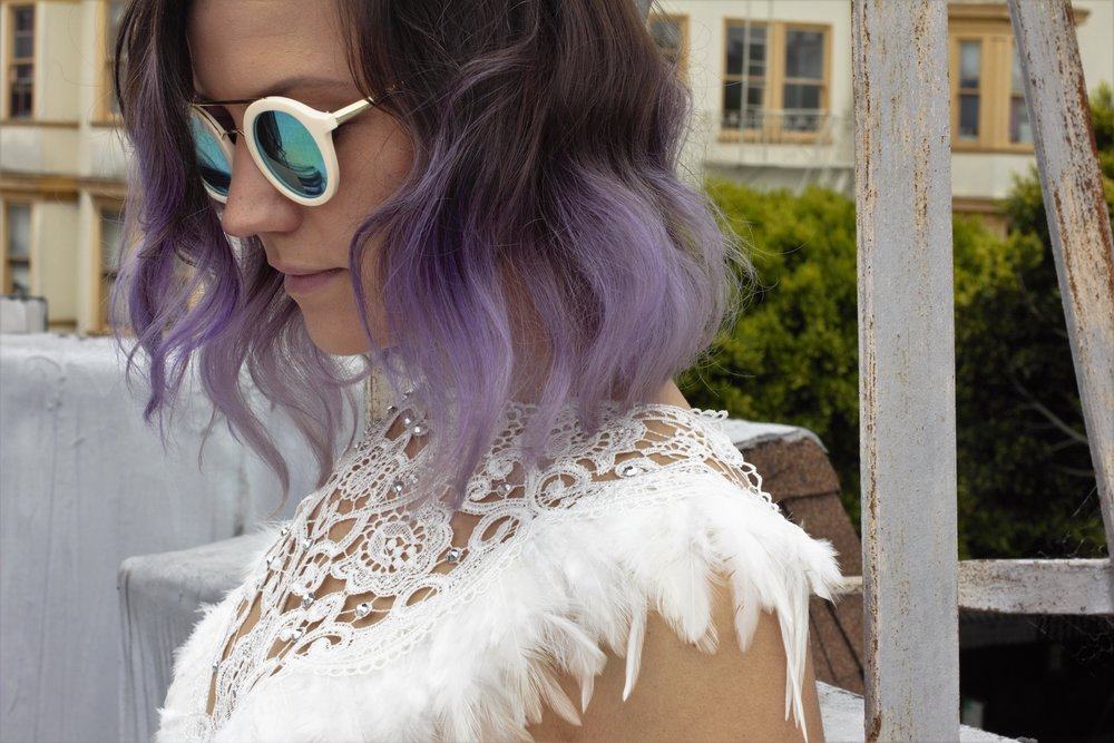 Womens feather top with lace bodice, boho outfits perfect for festivals