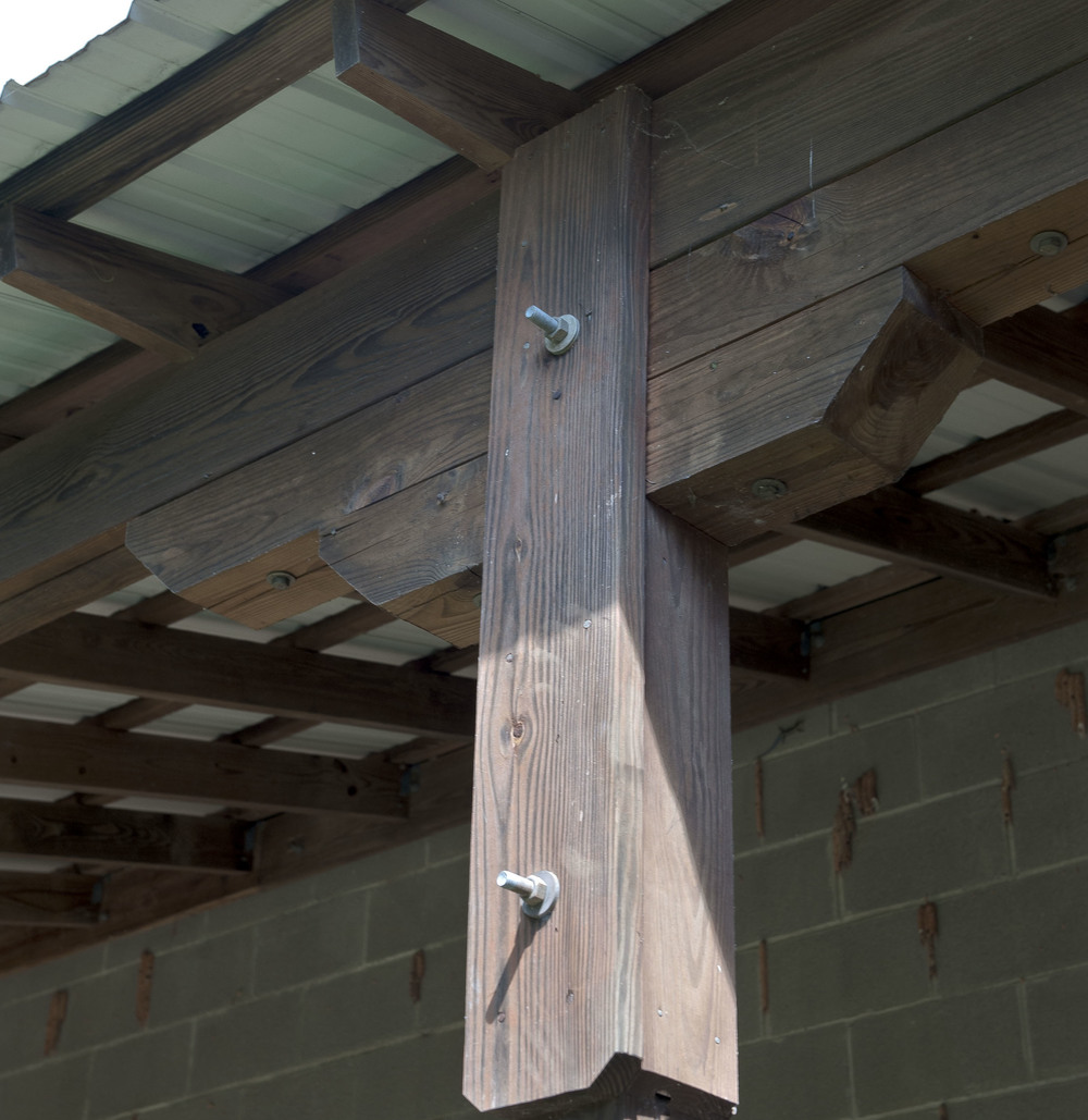 Carefully constructed wood columns frame the back porch.