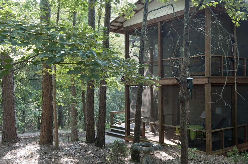 Upper sleeping porch and lower dining porch.
