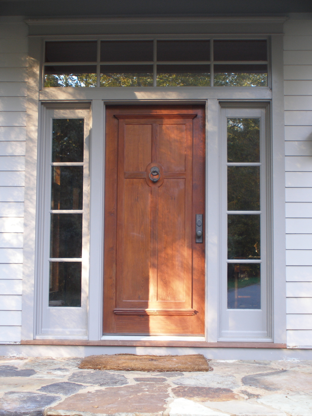 Double panelled heart pine front door.