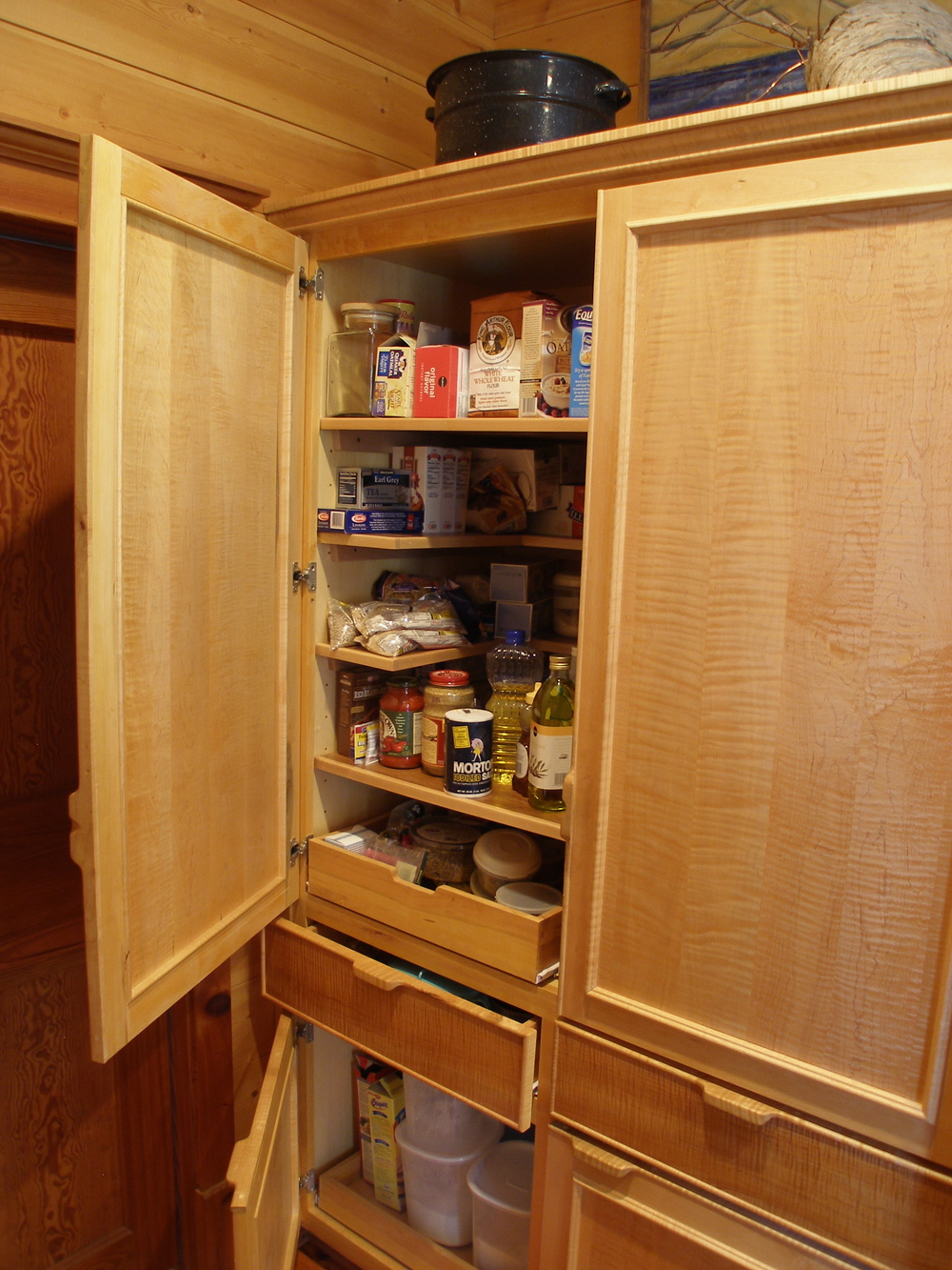 Custom pantry storage in curly maple.