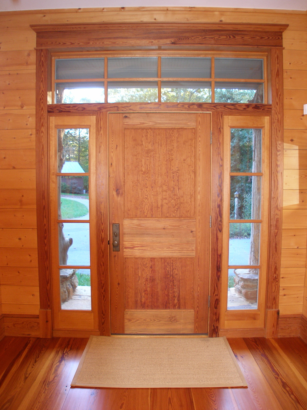 Inside of entrance door shows interior panel arrangement of curly pine panels.