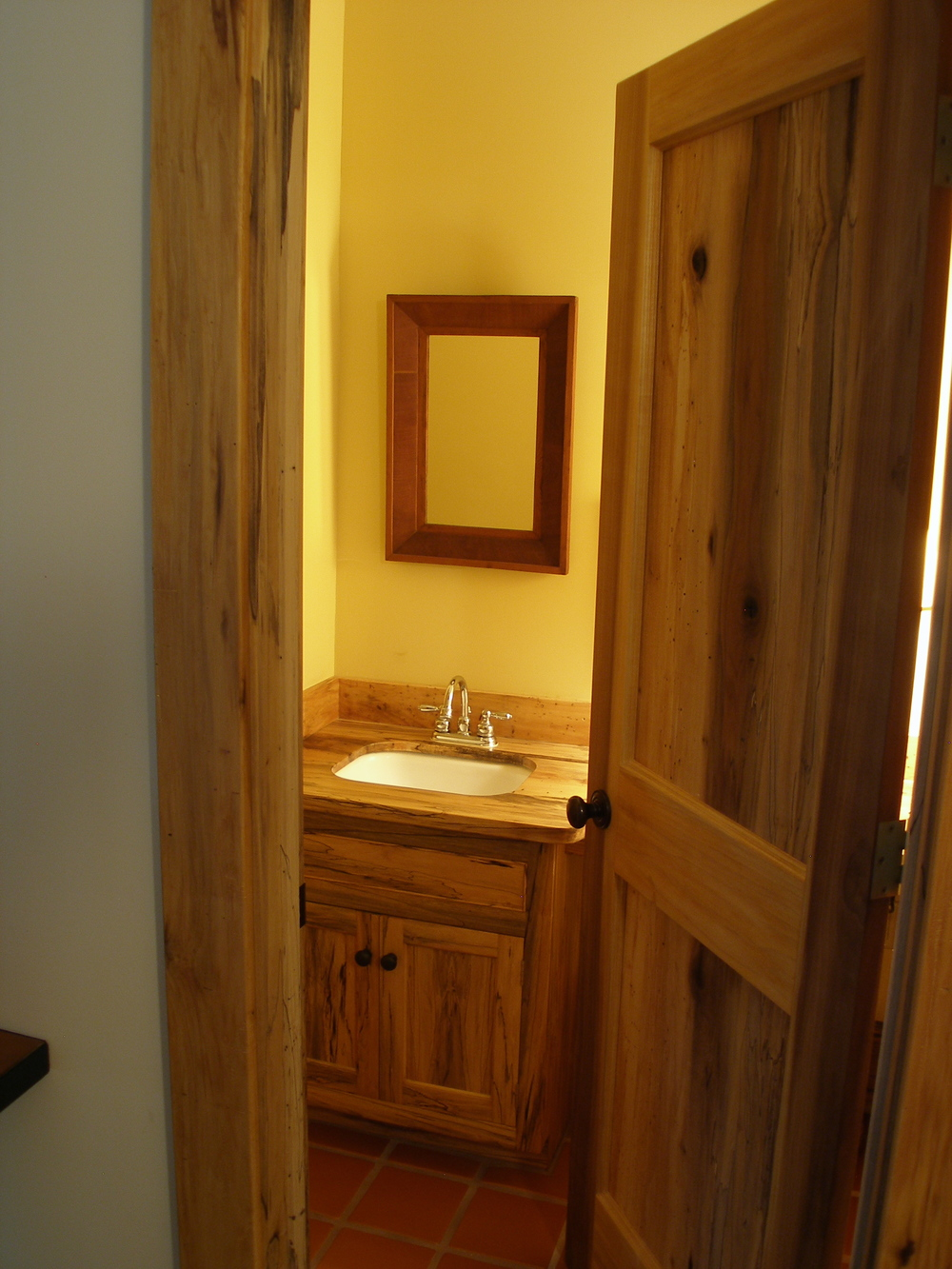 Spalted Poplar door and vanity cabinet in guest bath.