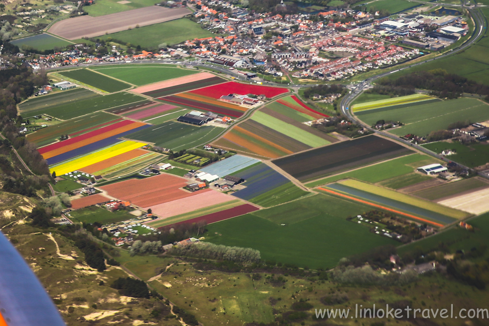 Multicoloured carpet strips of tulip fields. Photo taken  from my window seat during my flight into Amsterdam: