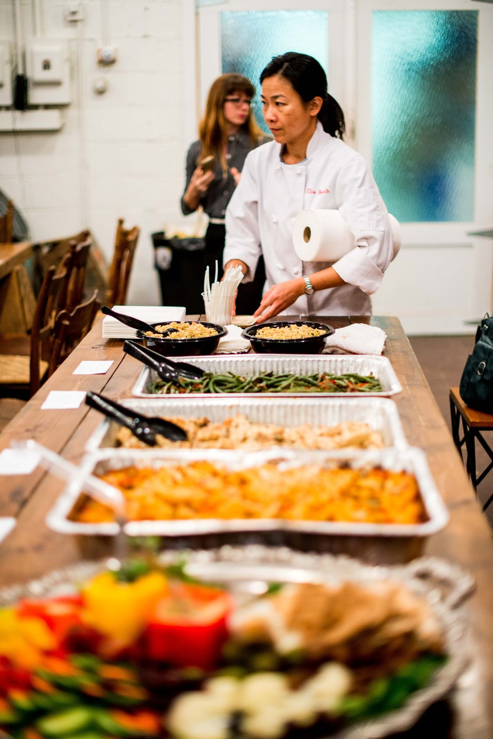 Ellie Basch of Everyday Gourmet sets up appetizers and a full-spread dinner for {un}convention attendees.  Photo by Melodie Ann Photography.