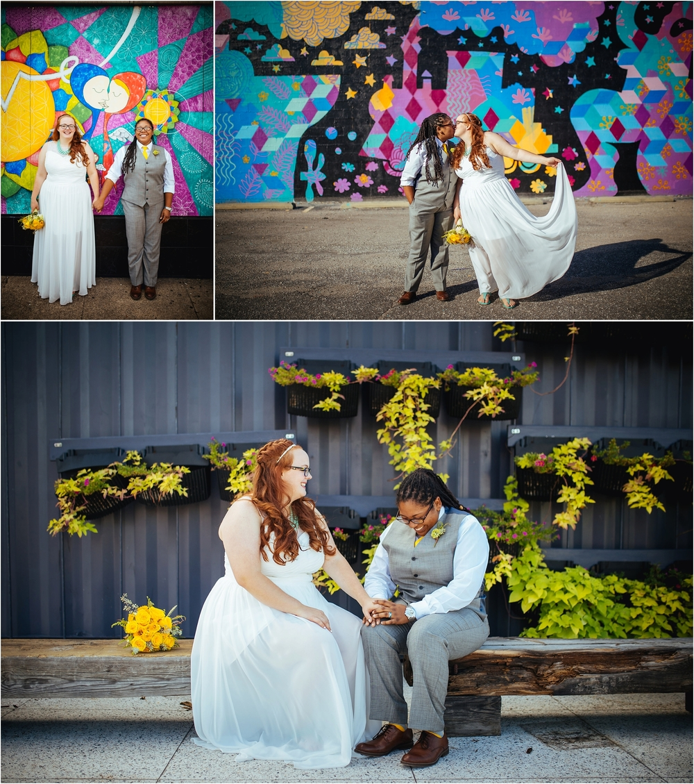A Lovely Photo Wedding Photography holding hands in front of mural, kiss, sitting on log bench
