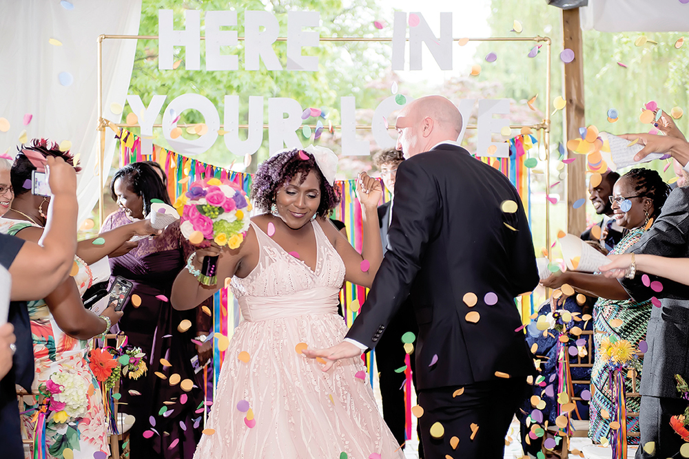 Milanes Photography couple showered in colorful confetti