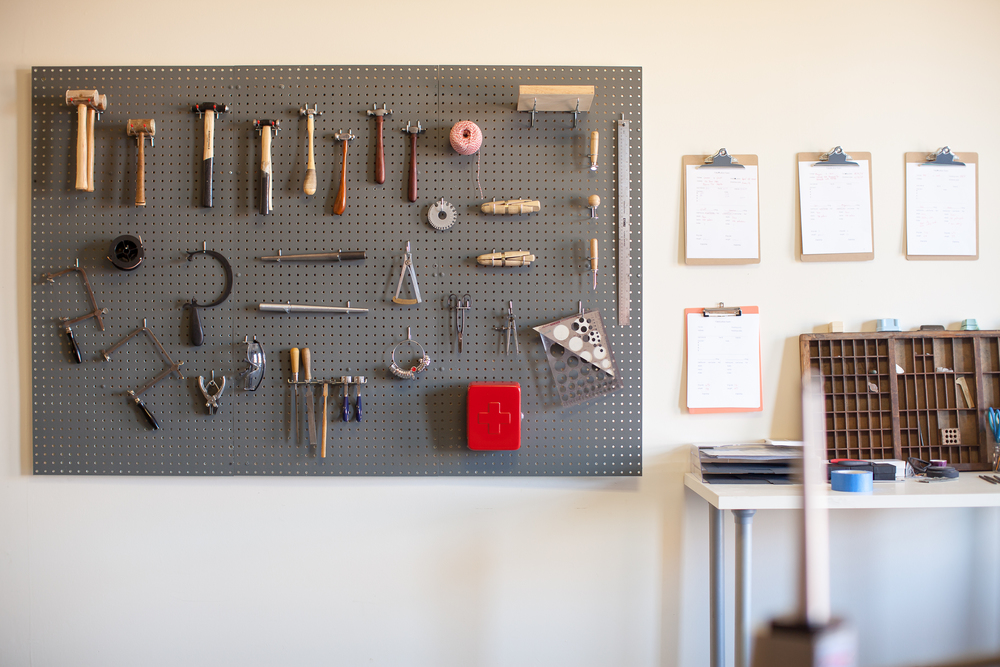 With these rings peg board with tools on wall