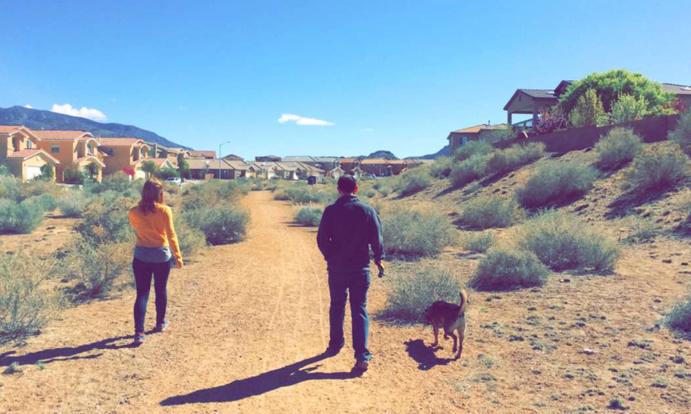 Adam Susong Walking in housing development in desert