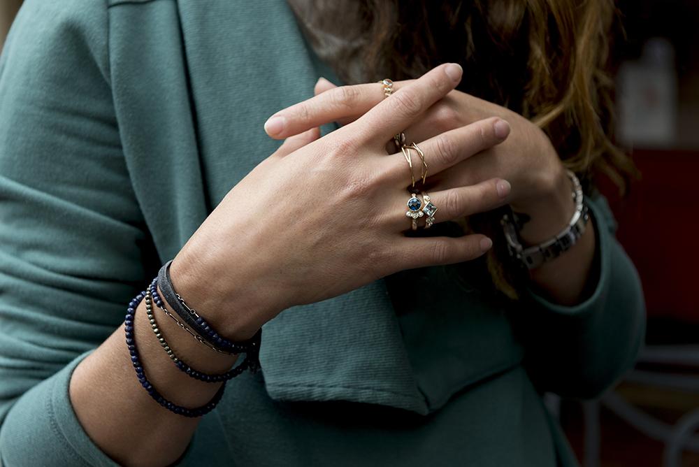 Elaine B Jewelry model wearing rings