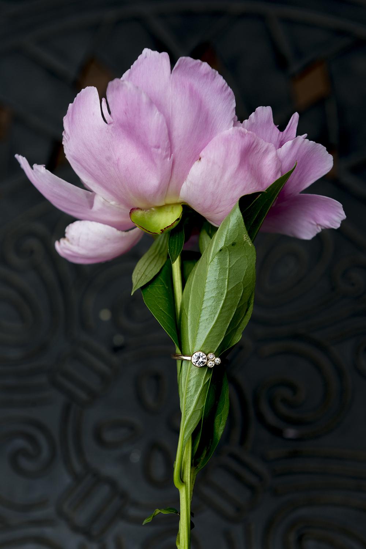 Elaine B Jewelry ring around flower