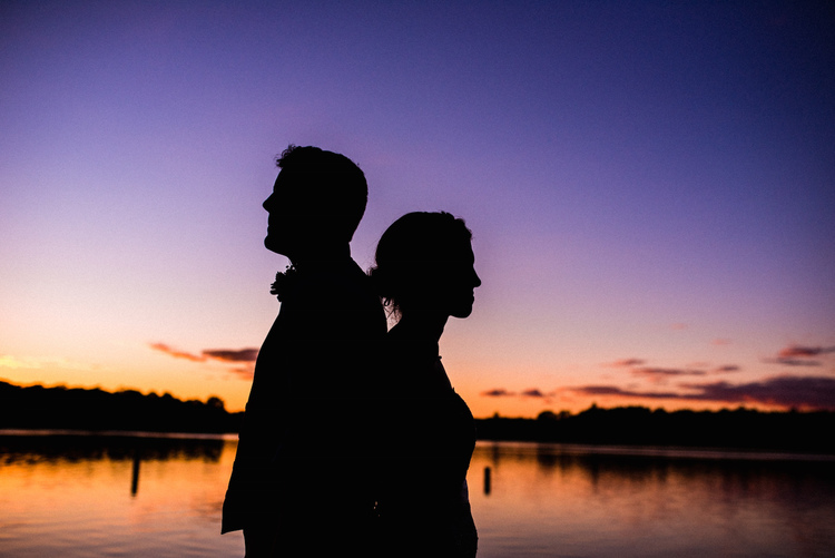 Roost Wedding Photography couple's back-to-back silhouette