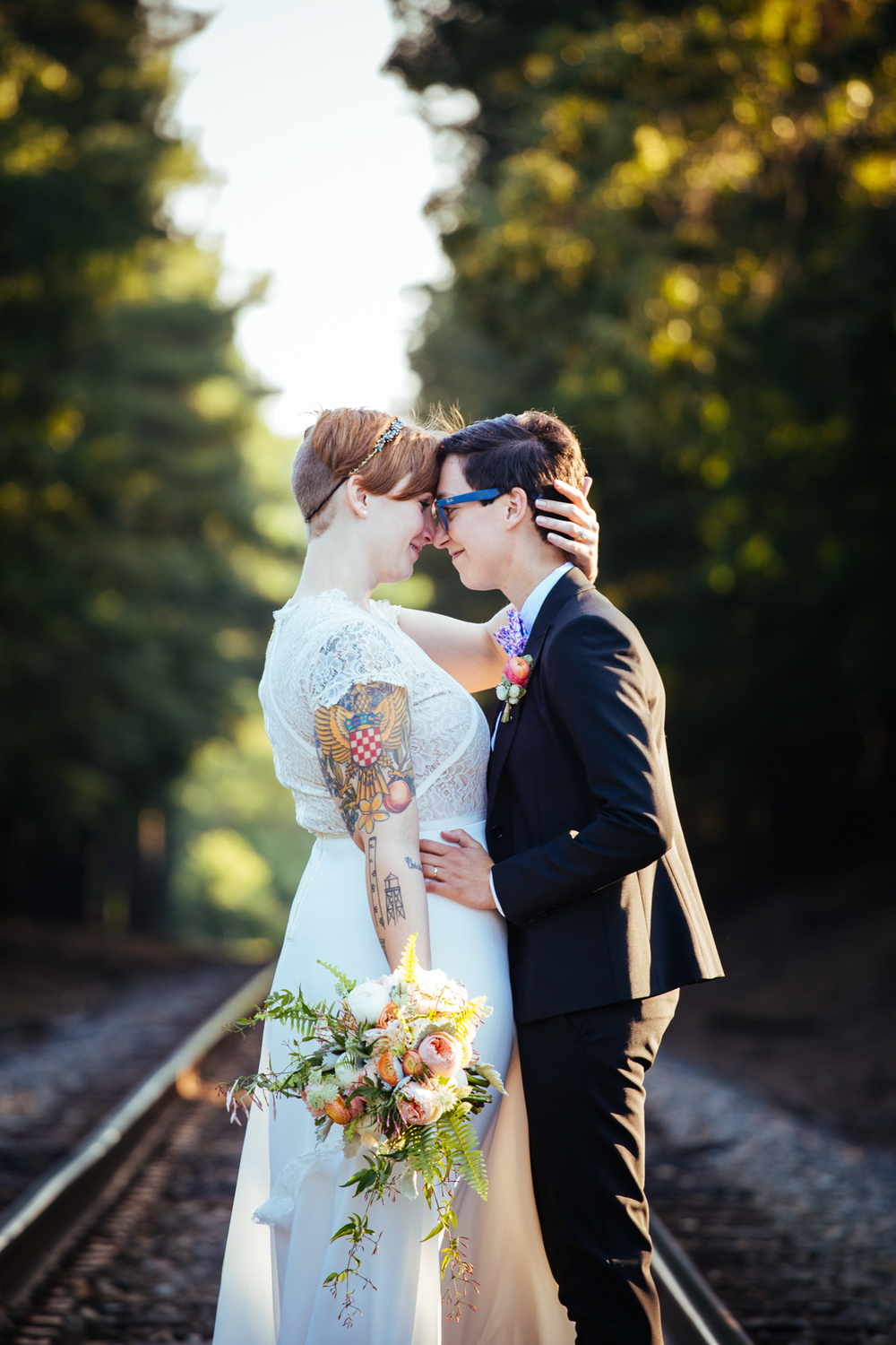 A Lovely Photo Wedding Photography embrace on train tracks