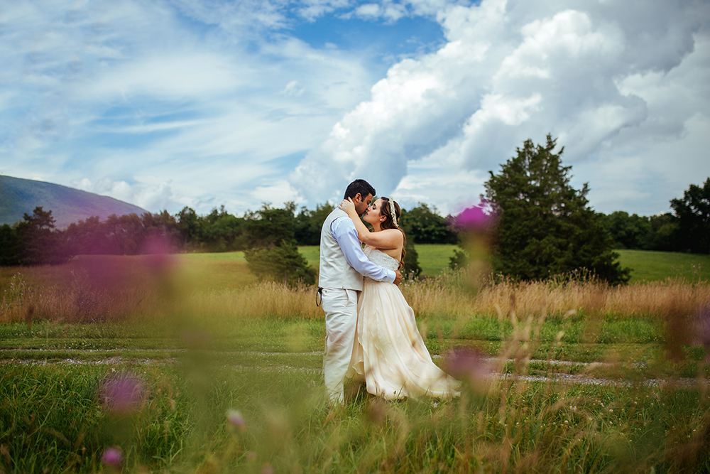 A Lovely Photo Wedding Photography kiss in field