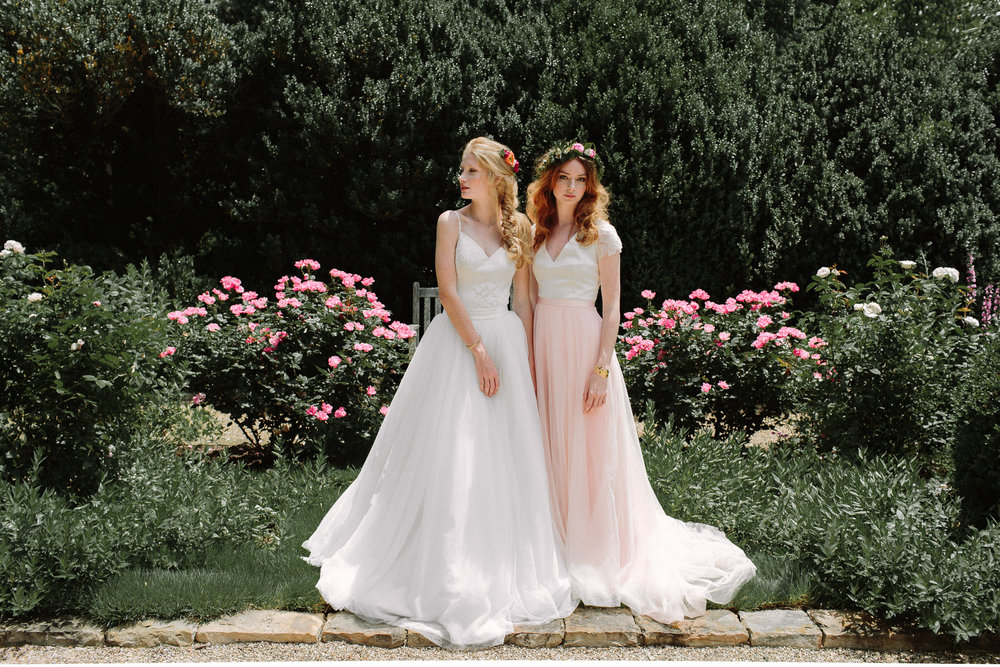Lace and Liberty Wedding Dresses pose in garden by betty clicker photography