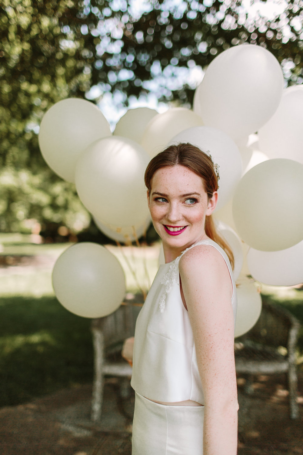 Lace and Liberty Wedding Dresses model with balloons