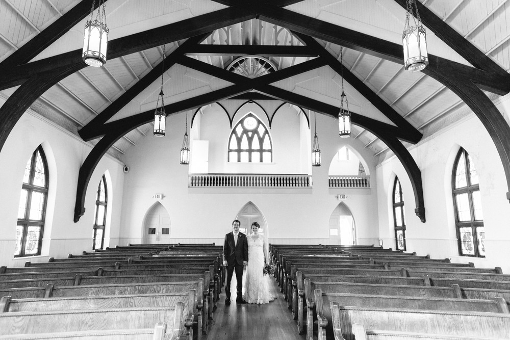 Betty Clicker Wedding Photography couple standing in aisle of empty church