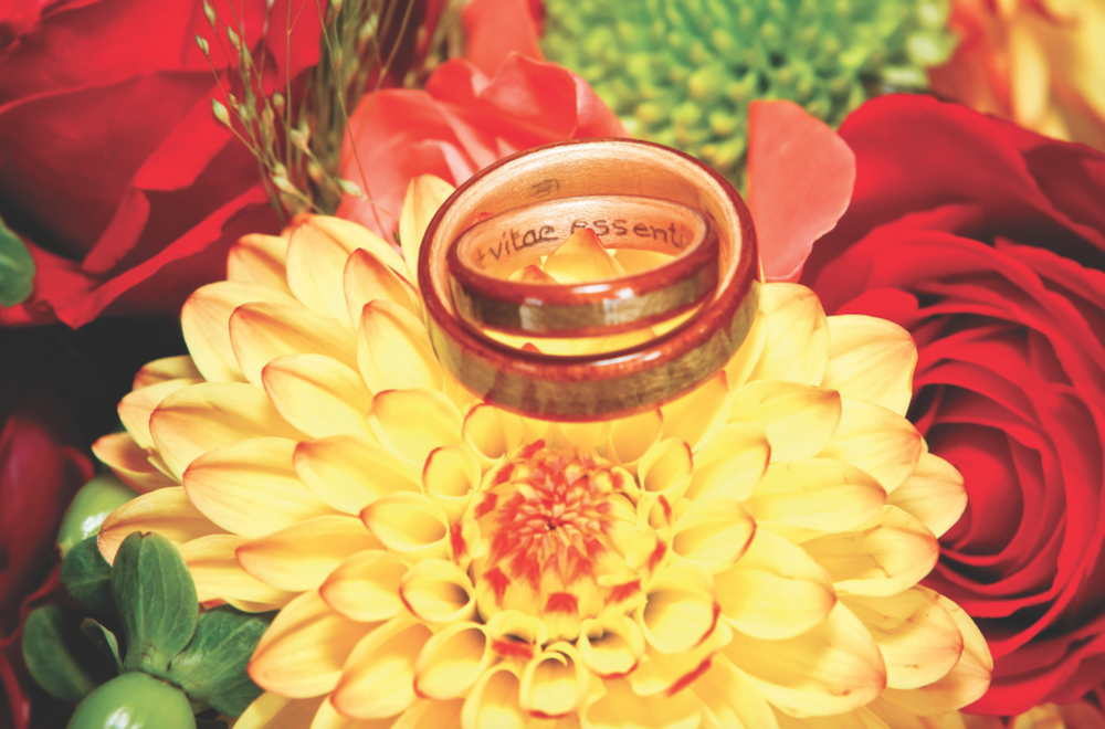 Touch Wood Wedding Rings Canada two wooden rings on top of flowers