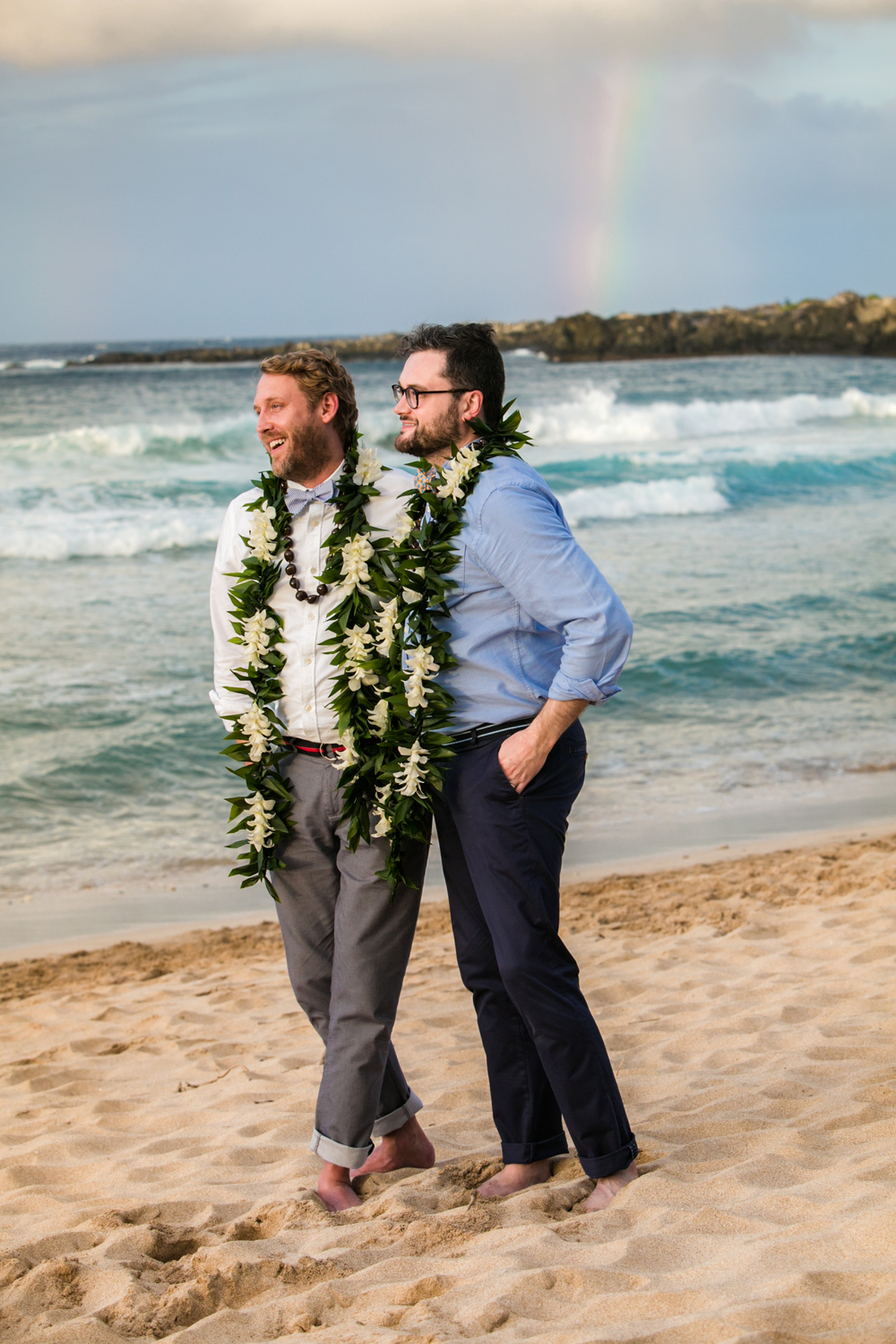Lisa25 Wedding Photography walking on beach with rainbow in background