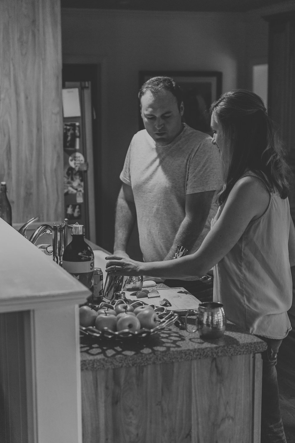 Kaitlyn Stoddard Wedding Photography Tennessee couple preparing limes in kitchen
