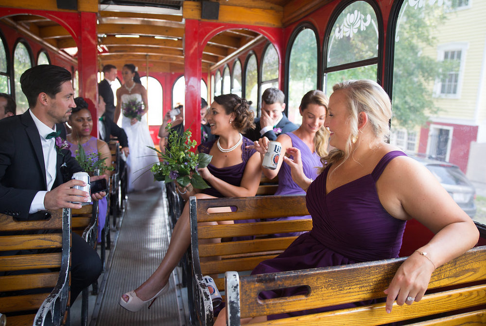 Megan Dickerson Wedding Photography North Carolina wedding party on trolley