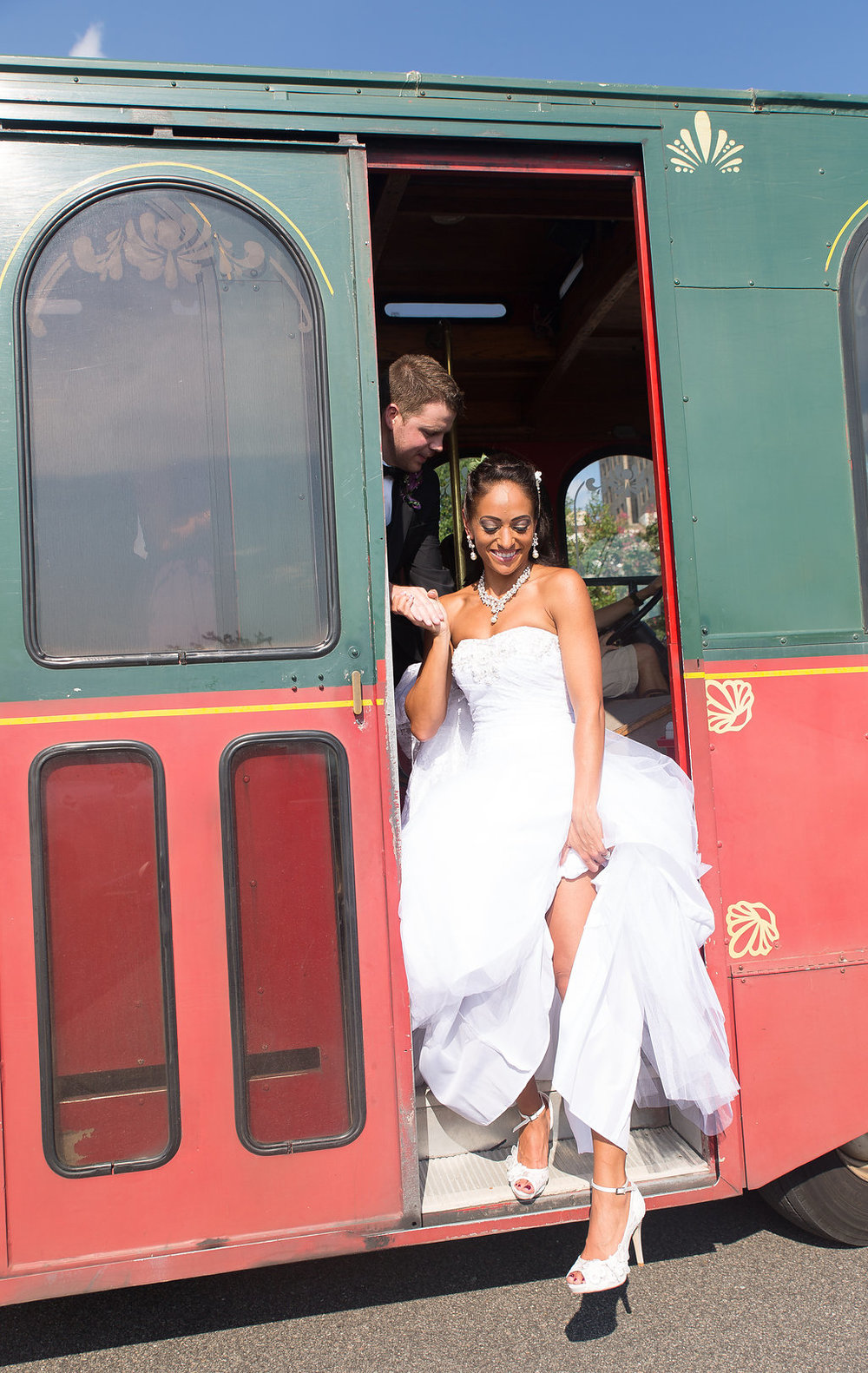 Megan Dickerson Wedding Photography North Carolina bride stepping off of trolley car