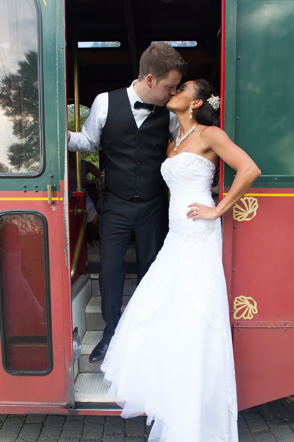 Megan Dickerson Wedding Photography North Carolina kiss on trolley car steps
