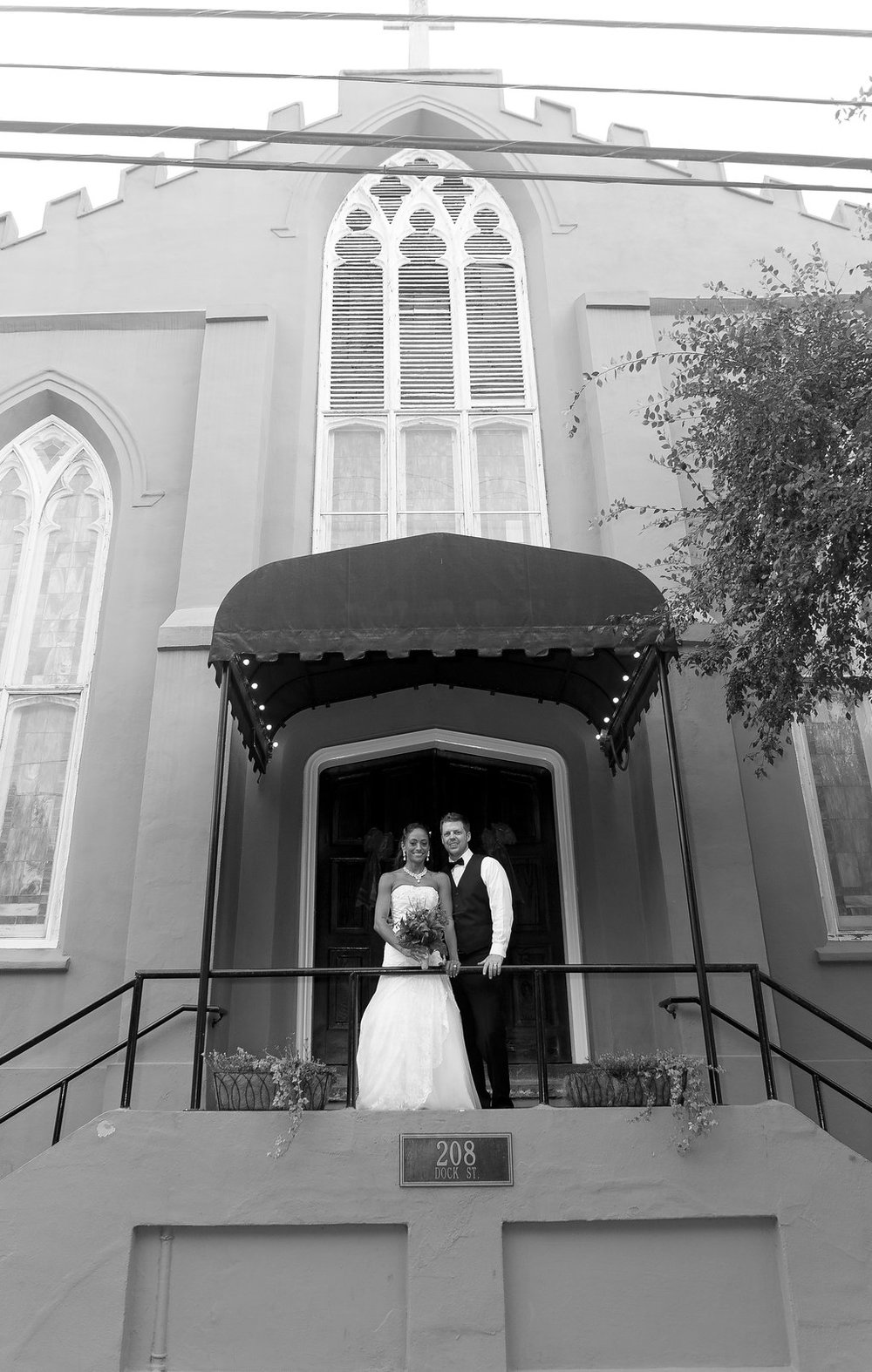 Megan Dickerson Wedding Photography North Carolina couple in front of church