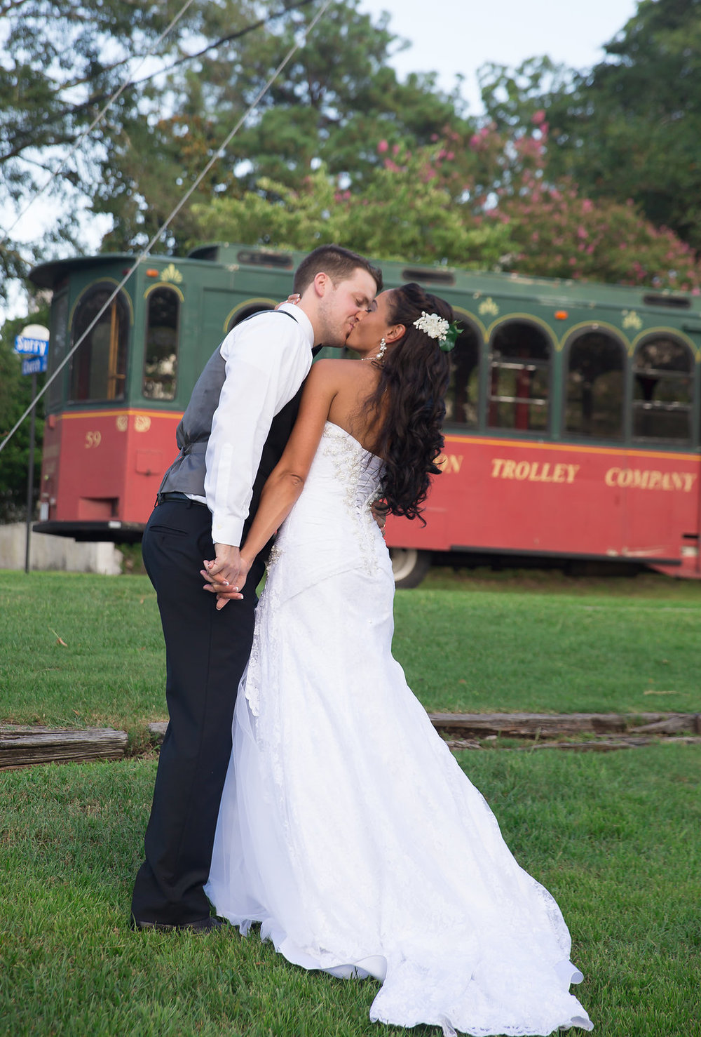 Megan Dickerson Wedding Photography North Carolina kiss in front of trolley