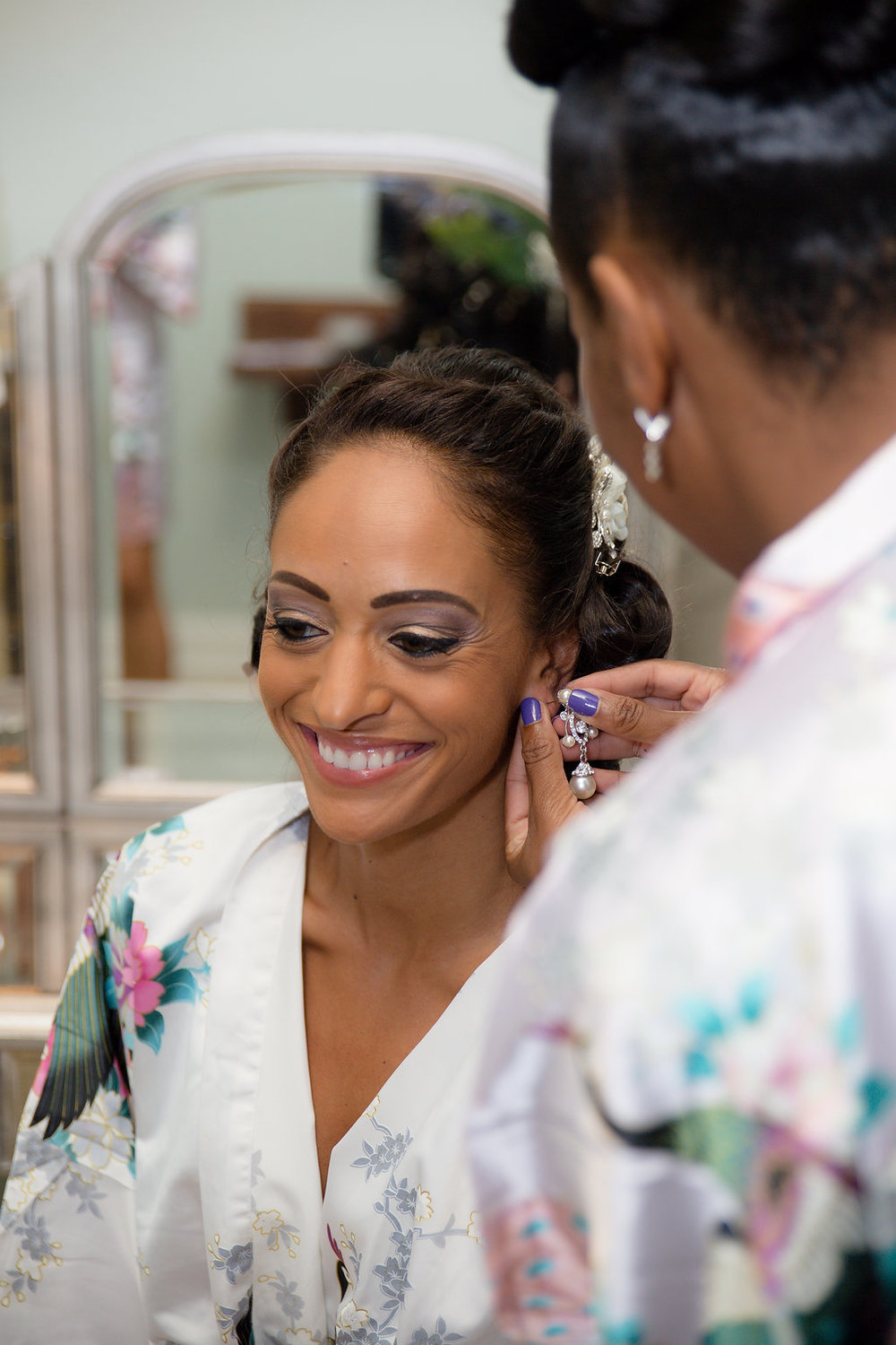 Megan Dickerson Wedding Photography North Carolina bridesmaid helping bride get ready
