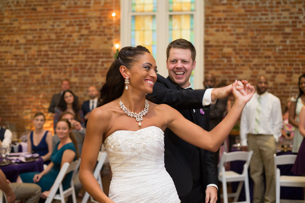 Megan Dickerson Wedding Photography North Carolina groom spinning bride dancing